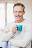 Handsome man having a cup of coffee Stock Images