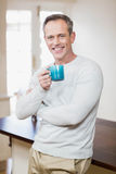 Handsome man having a cup of coffee Royalty Free Stock Image