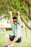Handsome man having fun in the park royalty free stock image