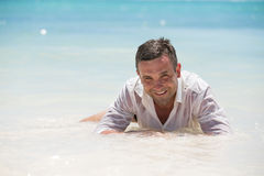 Handsome man having fun in wet shirt Stock Photography