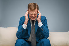Handsome man having a headache Royalty Free Stock Image