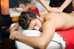 Handsome man having a massage Stock Images