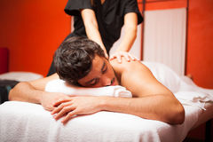 Handsome man having a massage Royalty Free Stock Photo