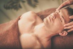 Handsome man having massage in spa salon Royalty Free Stock Photos