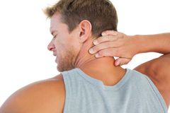 Handsome man having a neck ache Royalty Free Stock Photo