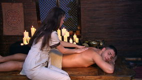 Handsome man  having oil Ayurveda spa treatment stock footage