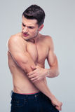 Handsome man having shoulder pain Stock Photos