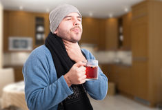 Handsome man having a sore throat Stock Images