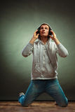 Handsome man with headphones listening to music Stock Image