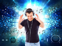 Handsome man with headphones and player buttons all around him. Casual handsome man with headphones and player buttons all around him, music love and joy stock photos