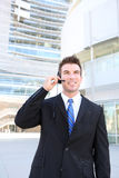 Handsome  Man on Headset. A young handsome customer service man with headset outside company building Royalty Free Stock Photo