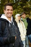 Handsome man hiking in forest smiling Royalty Free Stock Photography