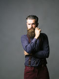 Handsome man hipster twirls moustache Royalty Free Stock Photo