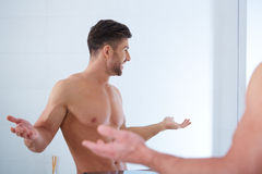 Handsome man in his bathroom Royalty Free Stock Photography