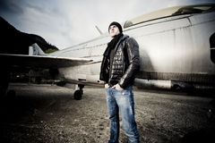 Handsome Man and his fighter plane Royalty Free Stock Photography