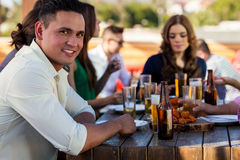 Handsome man with his friends Stock Images