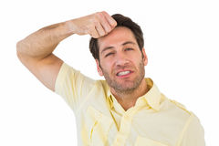 Handsome man with his hand on his forehead Royalty Free Stock Photos