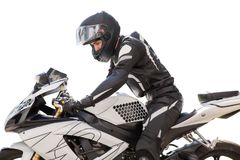 Handsome man with his motorcycle isolated in white. Motorcycle rider royalty free stock photography