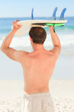Handsome man with his surfboard Royalty Free Stock Photo