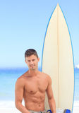 Handsome man with his surfboard Stock Photo