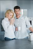 Handsome man and his wife enjoying coffee Royalty Free Stock Photo