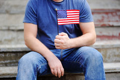 Handsome man holding american flag Stock Images