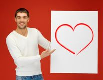 Handsome man holding big board with heart Stock Photography