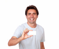 Handsome man holding a blank business card Royalty Free Stock Photo