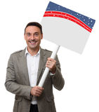 Handsome man holding a blank placard. Isolated Stock Photos