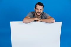 Handsome man holding a blank placard Stock Image