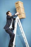 Handsome man holding the boxes Royalty Free Stock Photos