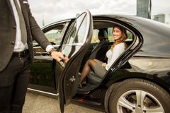 Free Handsome Man Holding Car Door For Beautiful Businesswoman Stock Image - 102064081