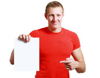 Handsome man holding card. Bright picture of handsome man holding blank note card paper Stock Image