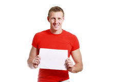 Handsome man holding card. Bright picture of handsome man holding blank note card paper Royalty Free Stock Images