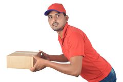 Handsome man holding carton box running fast Stock Photography