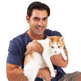 Handsome Man Holding a Cat Royalty Free Stock Image