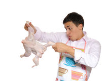 Handsome man holding chicken preparing to cook Stock Photo