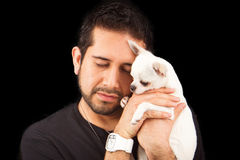 Handsome man holding a Chihuahua dog stock photo