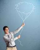 Handsome man holding cloud balloon drawing Stock Image