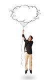 Handsome man holding cloud balloon drawing Royalty Free Stock Image