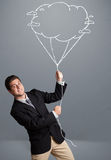 Handsome man holding cloud balloon drawing Stock Photos