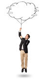 Handsome man holding cloud balloon drawing Stock Photo