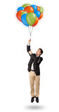 Handsome man holding colorful balloons Stock Photo