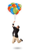 Handsome man holding colorful balloons Royalty Free Stock Image