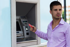 Handsome man holding a credit card Stock Image