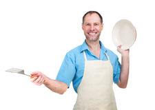 Handsome man holding a dish and a blade Stock Images