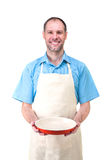 Handsome man holding a dish for your Stock Photos