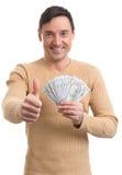 Handsome man holding dollar bills Royalty Free Stock Photography
