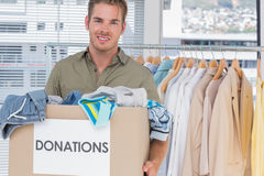 Handsome man holding donation box Stock Photography