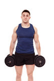 Handsome man holding dumbbells Stock Photography